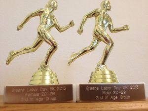 Adam and my trophies for the Labor Day 5k. :)
