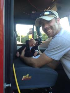 Can Daddy be any prouder? Adam introducing Titus to his first fire truck. (6 days old)
